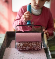 A five year old making her birthday cards with a patterned paint roller